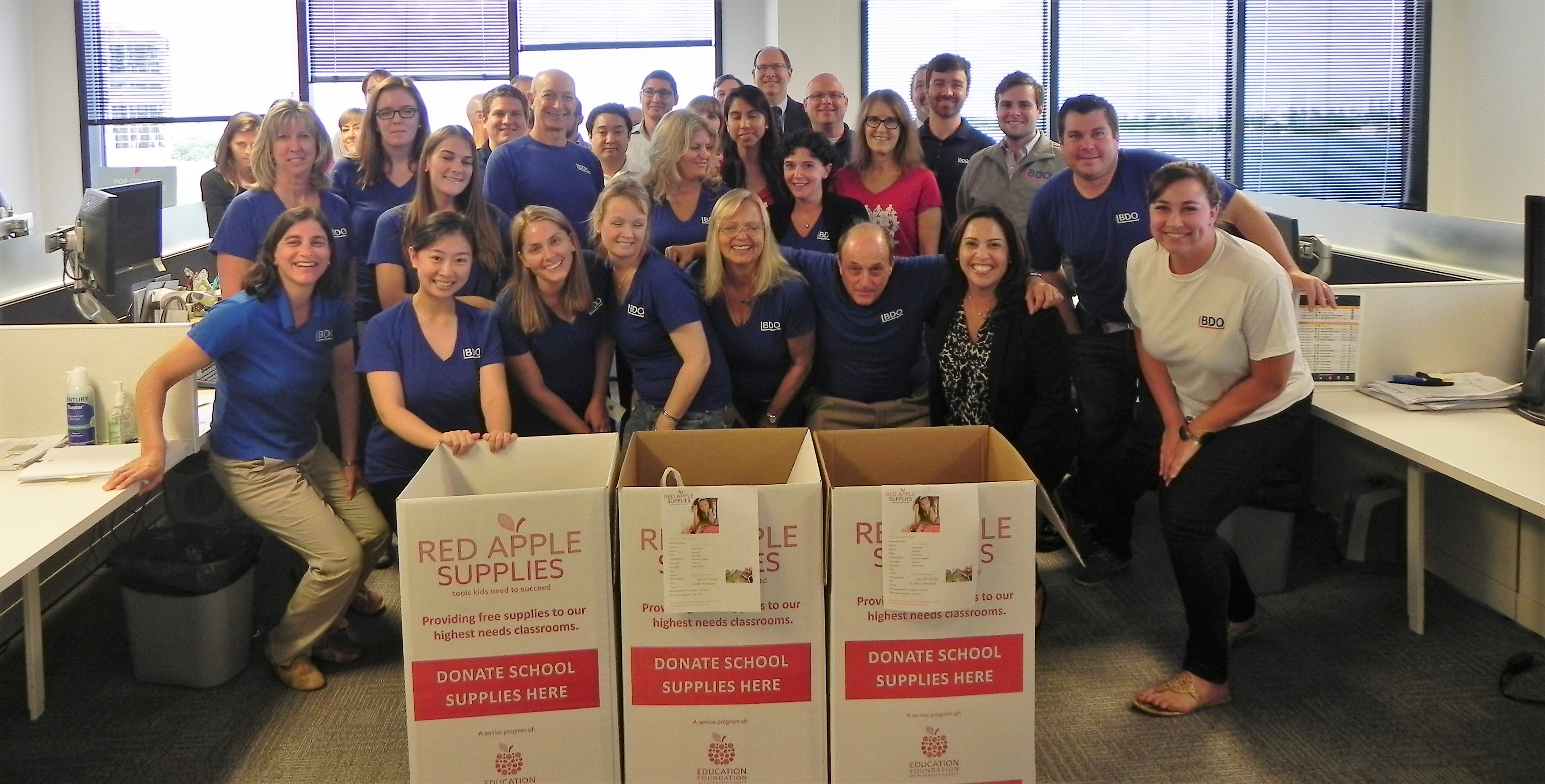 BDO employees celebrate their school supply drive